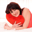 Woman with plush heart — Stock Photo