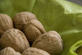 Walnuts on the green serviette — Stock fotografie