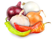 Motley onions, garlic and peppers — Stock Photo