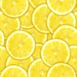 Stock Photo: Seamless pattern of yellow lemon slices