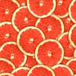 Seamless pattern of red grapefruit slices - Stock Photo