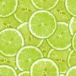 Stock Photo: Seamless pattern of green lime slices