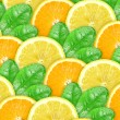 Bbstract background of orange and lemon with green leaf — Stock Photo