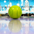 Sphere ball standing on bowling lane - Stock Photo
