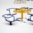 Children's play area in winter - Stock fotografie