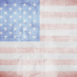 Stock Photo: Shabby USA flag on a white wall