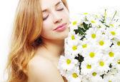 Beautiful girl with white chrysanthemum — Stock Photo