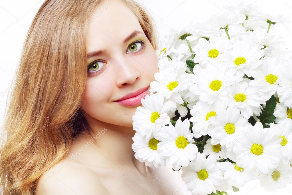 Beautiful girl with white chrysanthemum on a light background — Stock Photo #10048391