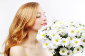 Beautiful girl with white chrysanthemum on light background — Stock Photo
