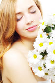 Beautiful girl with white chrysanthemum — Stock Photo