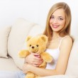 Attractive girl with a teddy bear — Stock Photo #8735280
