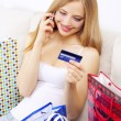 Girl with mobile phone and credit card — Stock Photo