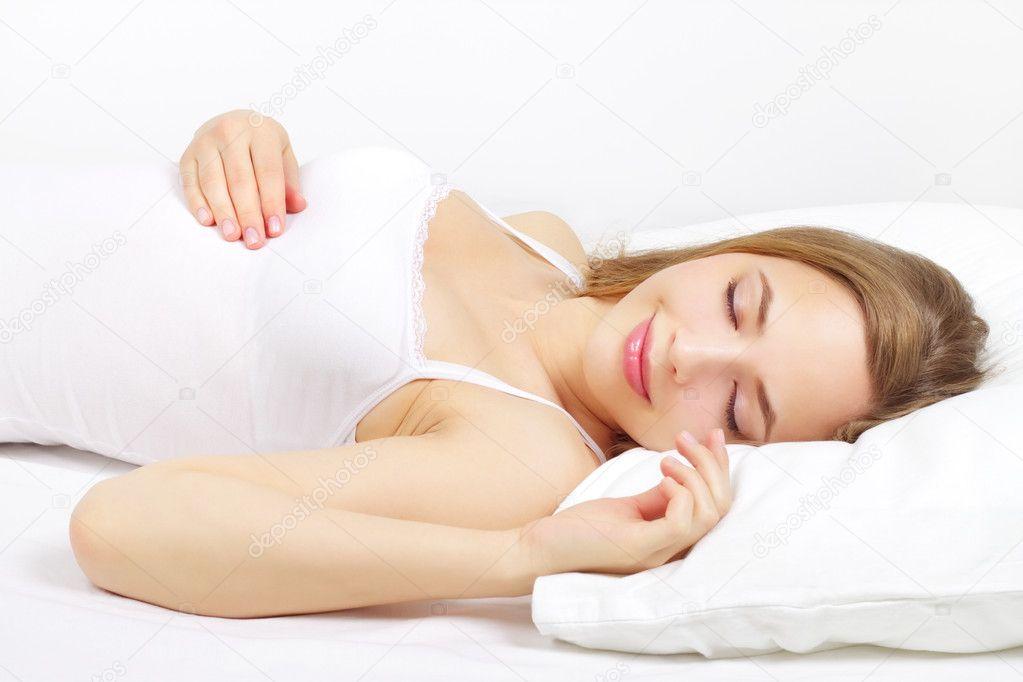 Sleeping Girl on the bed - Stock Image