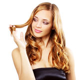 Beautiful girl with long wavy hair isolated on a white — Stock Photo