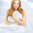 Beautiful girl in the clouds — Stock Photo #9460166