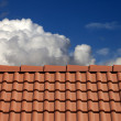 Roof tiles and blue sky with clouds — Stock Photo