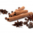 Cinnamon sticks, anise stars and black peppercorns — Stock Photo