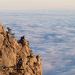 Стоковое фото: Sunlit cliffs and sein clouds
