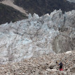 Hiker on glacier moraine — Stock Photo