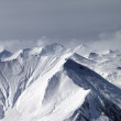 Stock Photo: Snowy mountains in haze