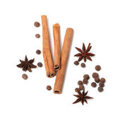 Black peppercorns, anise stars and cinnamon sticks — Stock Photo