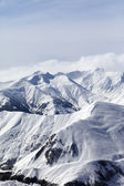 Snowy mountains in haze — Stock Photo