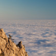 Evening rocks and sea in clouds - Stock Photo