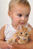 Cute child with a cat — Stock Photo