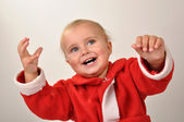 Happy Christmas baby with hands raised — Стоковое фото