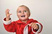 Smiling Santa toddler girl — Stock Photo