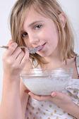 Smiling child with a bowl of milk porridge — Stock Photo