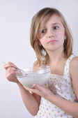 Thoughful child with a bowl of milk porridge — Stock Photo