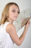 Beautiful girl with a fan — Stock Photo