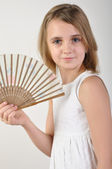 Child with a fan — Stock Photo