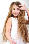 Child with long hair — Stock Photo