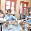 Children shaping clay in pottery studio — Stock Photo #9108915