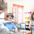 Kids shaping clay in pottery studio - Stock Photo
