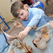 Group of hildren shaping clay in pottery studio — Stock Photo #9108982