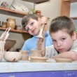 Children shaping clay in pottery studio — Stock Photo #9109127