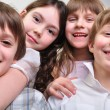 Happy group of children hugging together — Stock Photo #9413656