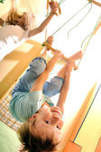 Happy children doing sports gymnastics — Stock Photo