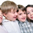 Happy children friends hugging together — Stock Photo #9723346