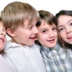 Happy children friends hugging together — Stock Photo