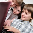 Group of children friends playing computer games — Stock Photo