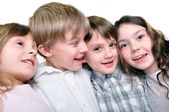 Happy children friends hugging together — Stock Photo