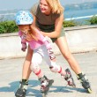 Child on inline rollerblade skates — Foto Stock