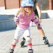 City park family rolleblading on roller skates together — Stok fotoğraf