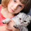 Child with her pet cat — Stock Photo