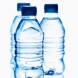 Purified spring mineral water in the bottles with reflection — Stock Photo