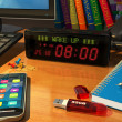 Digital alarm clock on table — 图库照片